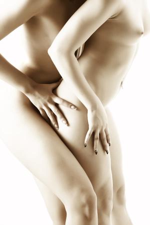 Primer plano el cuerpo desnudo de la mujer en dos temptetion sexual en clave de alta Foto de archivo - 12624430