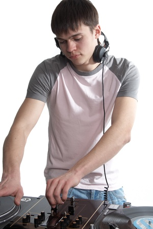 Young disk jockey for thw vinyl disks and mixer Stock Photo - 12552916