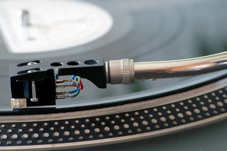 Close up acoustic vinyl disk player with acoustic pickup photo
