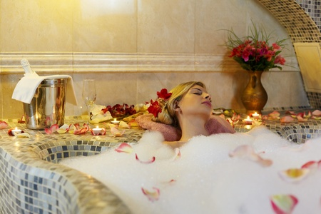 Young woman in spa bathroom in bath with water Stock Photo - 13240731