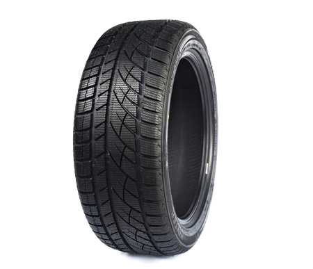 radial tire: Black rubber car wheel against white background with protector