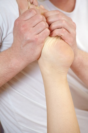 Mans hands on the lady foot in massage Stock Photo - 13405195