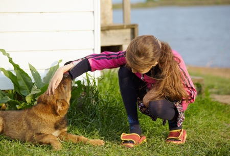Baby animal dog and girl at the outdoor in summer photo