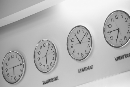 timezone: Watches dial plates diferent time zones on the wall