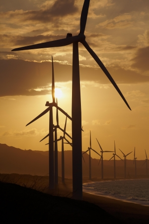Windmills on the sea cost against sunset, north Philippines Stock Photo - 16634870