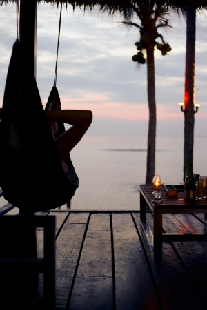 Sunset in dusk tropical sea, view from resort relaxing place Stock Photo