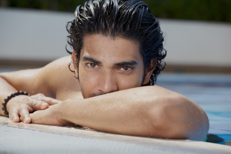 wet hair: Casual lifestyle outdoor portrait handsome guy in pool Stock Photo