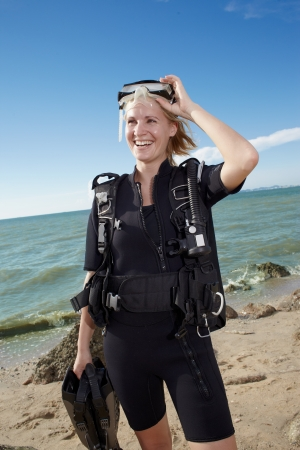 portrait young woman in diver swimsuit on the island seaside photo