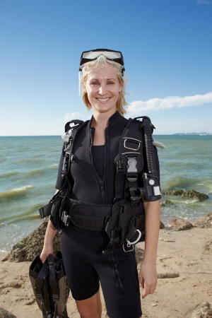 portrait young woman in diver swimsuit on the island seaside 版權商用圖片
