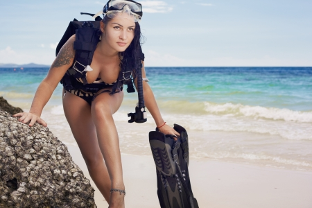 Phashion lifestyle portrait young woman in underwater equipment at the outdoor photo