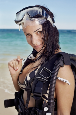 scuba goggles: Phashion lifestyle portrait young woman in underwater equipment at the outdoor