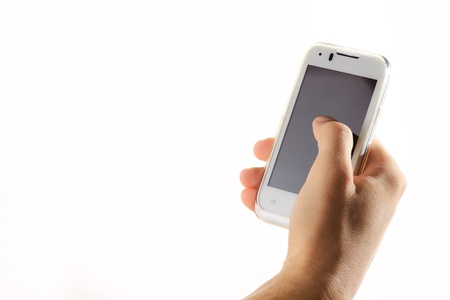 Close up mans hand with phone against white background Stock Photo - 21432052