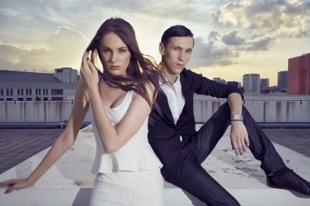 Guy and girl models in glamour fashion style at the outdoor