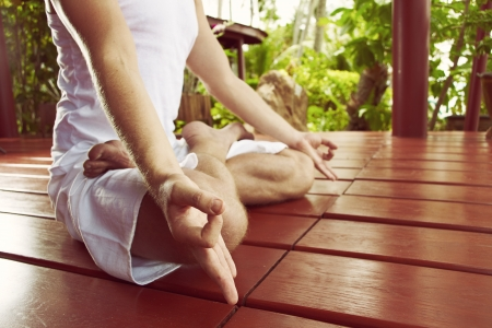 asanas: Close up man in hatha-yoga meditation in lotus asana