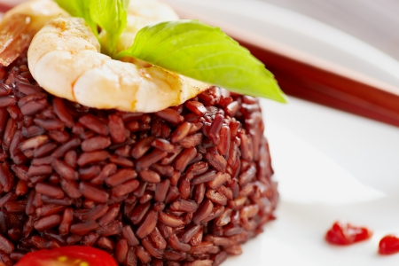 black rice: Food style close-up black rice and shrimps top with tomato Stock Photo