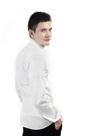 Three quarter portrait man in white shirt against white photo