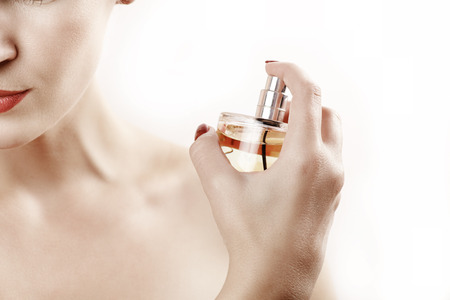 parfume: Close up beauty woman portrait with parfume against white Stock Photo