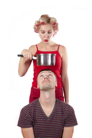 funy: Household woman in red topic and rollers with pan and man against white