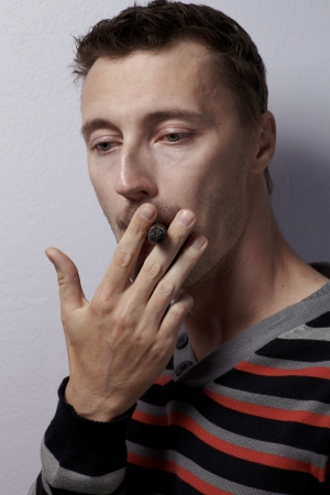 deleterious: Caucasian man portrait with cigar in studio