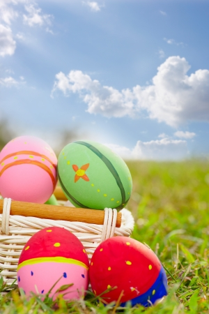 hunts: Close up easter painted eggs on the green meadow grass Stock Photo