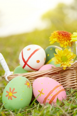 Close up easter painted eggs on the green meadow grass photo
