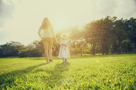 Mum and daughter outside in the park 版權商用圖片