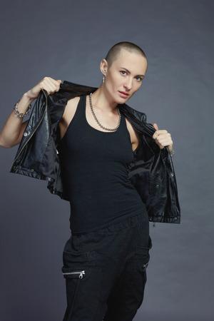 Studio fashion portrait with bald female model in dark area Banco de Imagens - 33653214