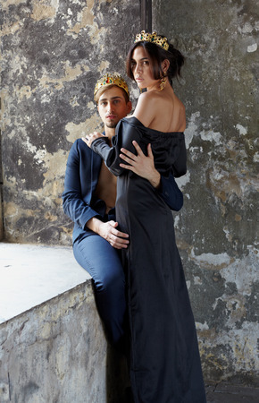 Fashion models couple king and queen in abandoned interiorrs photo