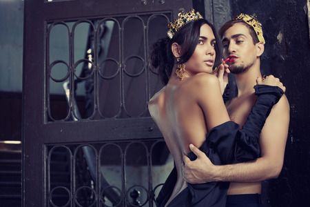 Fashion models couple king and queen in abandoned interiorrs Stock Photo