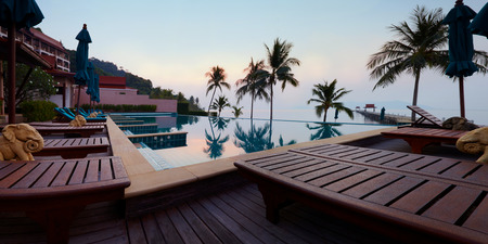 Tropic resort pool against sealine and daybreak light in morning Koh Chang, Thailand Panoramic picture 新聞圖片