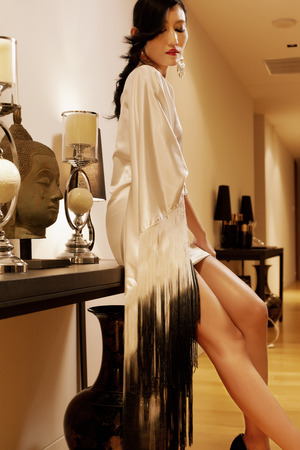 Asian model in luxxury room with evenig ambient light photo