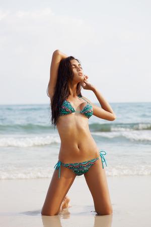 hot girl nude: Asian fashion model in bikini on the sea coast Stock Photo