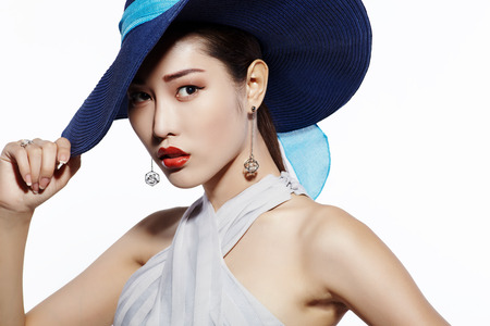 asian natural: Asian fashion model in hat against white background