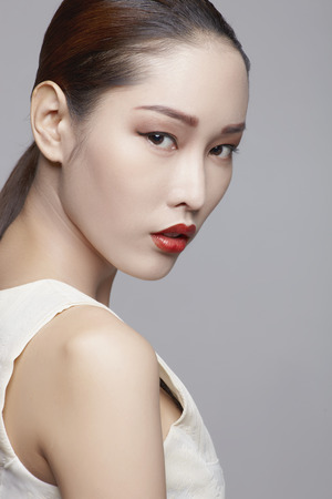 east asia: Asian female beauty model in studio against gray background