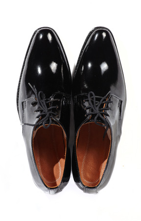 shoestrings: Couple men leather classic style shoes on white background