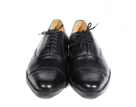 foot gear: Couple men leather classic style shoes on white background