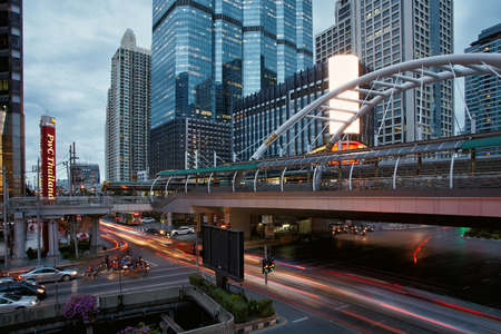 crowded space: Bangkok-Thailand, June 26: Dusk time in downtown Bangkok interception with traffic on the road, June 26, 2015