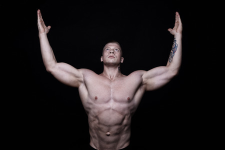 body builder: Studio portrait sports body builder man with big muscles