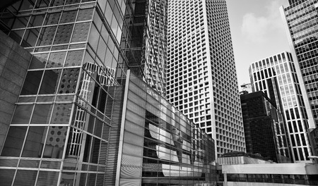 properties: City modern architecture in perspective, tall buildings in black and white