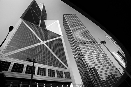 City modern architecture in perspective, tall buildings with sky in black and white