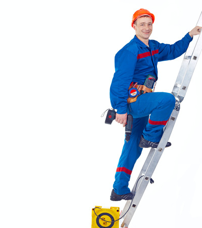 Technician engineer with equipments on the stapladder against white background photo