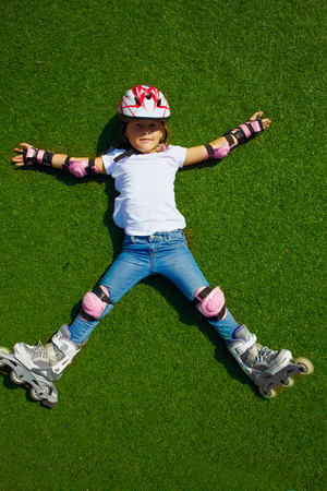wheather: Outdoor lifestyle young girl portrait on the roller skate in the stadium at sunny wheather