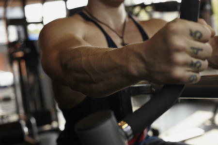 powerful man: Strong caicasian man at the gym does his workout Stock Photo