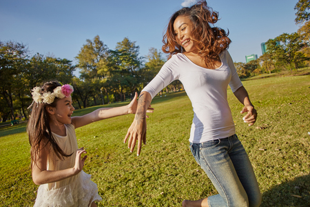 grass beautiful: Lifestyle portrait mom and daughter in happines at the outside in the meadow