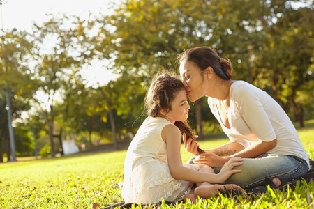 asian family fun: Lifestyle portrait mom and daughter in happines at the outside in the meadow