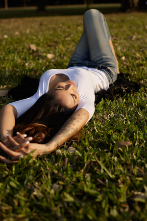 grass beautiful: Portrait asian woman luying on the grass in park
