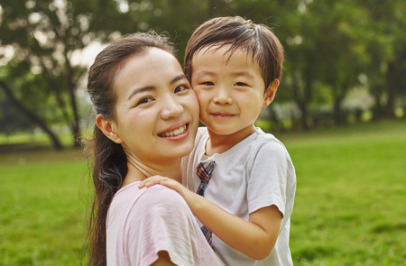 Asian family mom and boy in the park Standard-Bild
