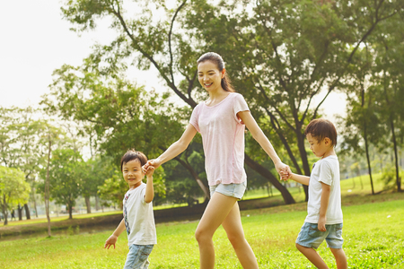 kiddy: Asian family mom and two twins boys in the park