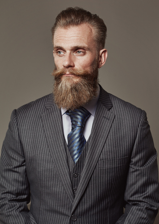 hair studio: brutal man with beard in classic suit in modern style portrait Stock Photo