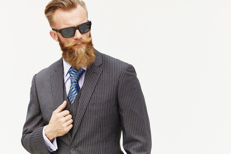 Handsom beard male model in suit and sunglasses against white background 版權商用圖片 - 51929895